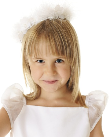 Closeup of a beautiful shy angel dressed all in white.  On a white background.