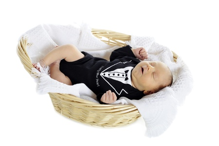 A handsome newborn in a blanket lined basket, wearing a tux with the message  Happy New Year    On a white background Stock Photo - 15763281