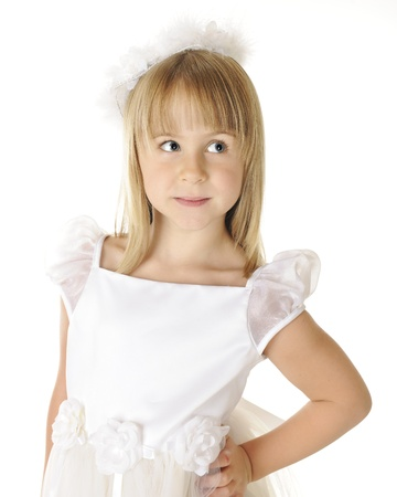 Portrait of a beautiful young girl dressed on in white   On a white background  photo