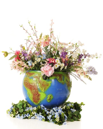 A large topical globe filled to overflowing with colorful flowers and greenery   On a white background