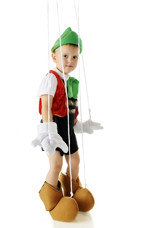An adorable preschool Pinocchio marionette standing with strings and all.  On a white background. Stock Photo - 16168630