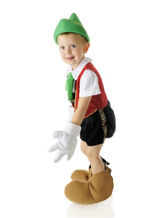 glove puppet: Side view of an adorable preschool real live boy Pinocchio.  On a white background.