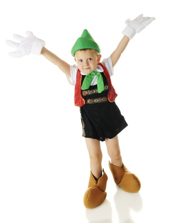 An adorable preschool Pinocchio with arms raised in gesture that hes no longer a puppet but a real live boy.  No strings!  On a white background.