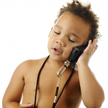 An adorable, bare-chested preschooler, eyes closed, pretending to talk on a cell phone.  On a white background. Stock Photo - 16366793
