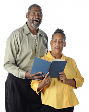 hymn: A happy senior African American couple sing a duet from the same book.  On a white background.