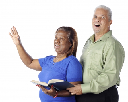 hymn: A senior African American couple singing praises together from a hymnal.  On a white background. Stock Photo