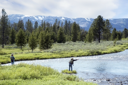 fly fishing: Scenic view of a man and woman fly fishing