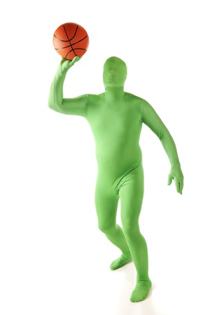 A green morph poised to shoot his basketball.  Isolated on white. photo