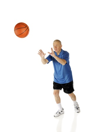 A senior man shooting a basketball   On a white background