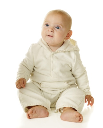 High-key portrait of an adorable blue-eyed baby boy   On a white background  Stock Photo