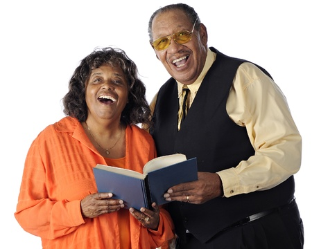 A senior African American couple sing together from a songbook   On a white background