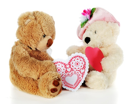 Two adorable toy bears exchanging hearts on Valentine Stock Photo - 17039635