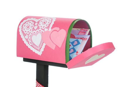 An opened valentine mailbox filled with loving cards   On a white background