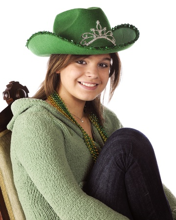 A pretty young teen dressed for St  Patrick s Day   On a white background Stock Photo - 17036330