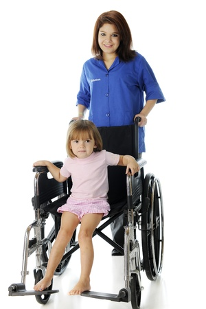 A pretty young hospital volunteer wheeling an adorable preschool patient in large wheelchair   Focus on child   On a white background  Stock Photo - 17036297