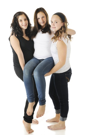 Two young, barefoot teens carrying an injured friend between them.  On a white background.