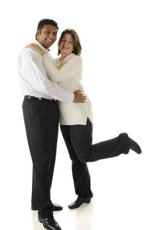 A mature biracial couple standing while happily embracing each other   On a white background  Stock Photo - 17147939