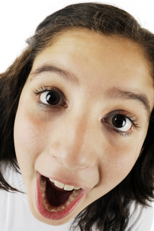 mouth opened: Close-up, fisheye view of an opened-mouth young teen girl    Stock Photo