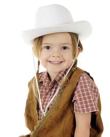 Closeup of an adorable little cowgirl   On a white background Stock Photo - 17165330