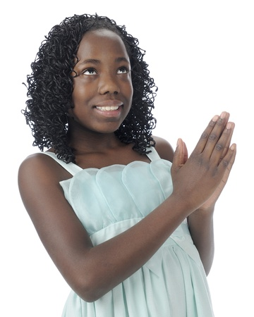 beautiful preteen girl: Close-up image of a beautiful tween happily looking heavenward in prayer.  On a white background. Stock Photo
