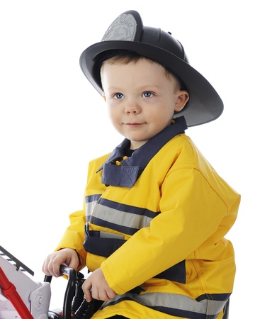 slicker: Close-up image of an adorable toddler boy dressed as a fireman   On a white background  Stock Photo