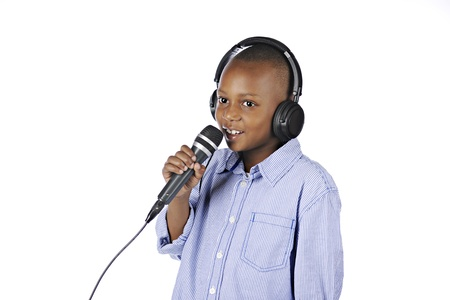 dj boy: A handsome elementary boy speaking into the microphone he holds while wearing a DJ headset.  On a white background.