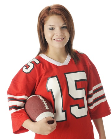over sized: A waist-up image of a beautiful teen girl in an over sized red jersey   She Stock Photo