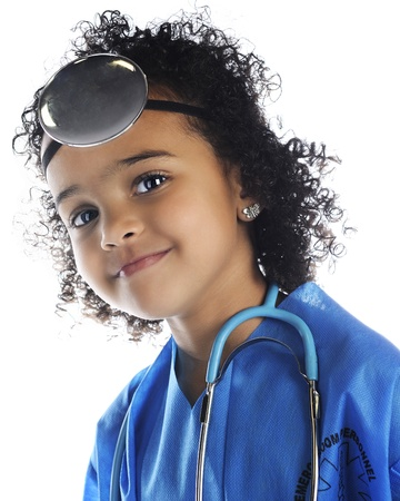 Closeup portrait of a beautiful preschool 'doctor.  On a white background. photo