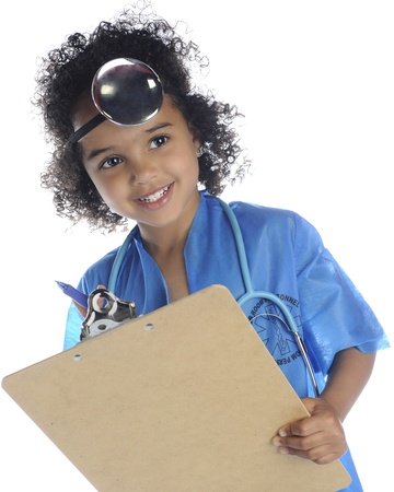 An adorable preschool doctor looking up from her clipboard.  On a white background.
