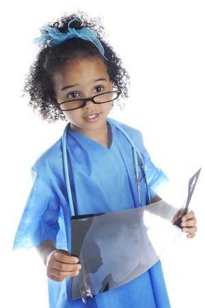 An adorable preschool doctor peering over her glasses as she examines the x-ray shes holding.  On a white background. Stock Photo