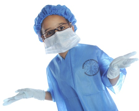A preschool doctor prepped for surgery with her cap, scrubs, glasses, mask and gloves.  On a white background.