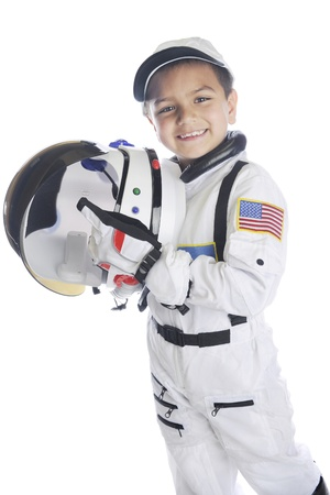A happy young elementary astronaut  happily holding his helmet while wearing his space suit.  On a white background.