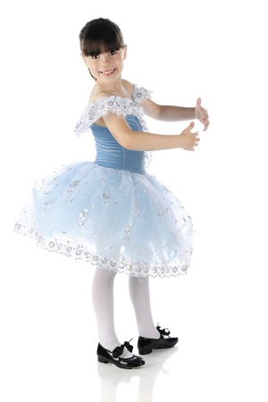 lacey: A beautiful elementary tap dancer smiling at the viewer as she poses in a dance form.  On a white background.