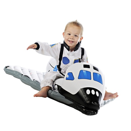 space shuttle: An adorable barefoot baby astronaut happily flying on  his space shuttle   On a white background  Stock Photo