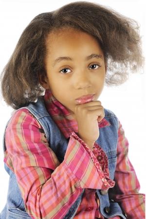 Close-up image of a contemplative elementary girl.  On a white background. photo