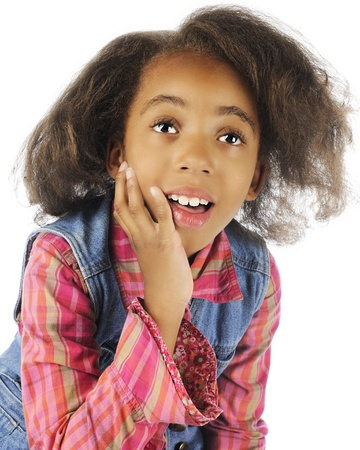 intrigued: Close-up image of an intrigued elementary girl.  On a white background. Stock Photo