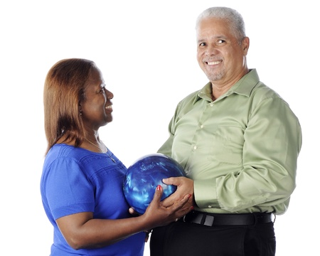 A senior adult couple happily posing with their bowling ball.  On a white background. photo