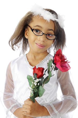 dressy: A dressy, young elementary girl happily carrying red roses.  On a white background.