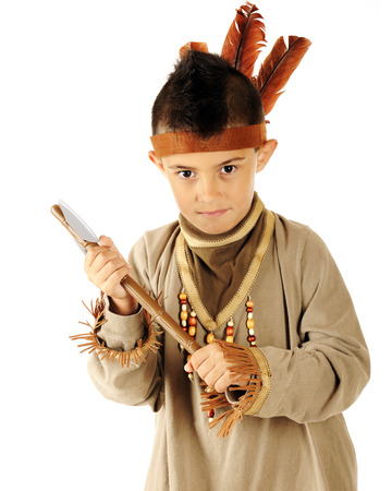Closeup of an elementary Indian with his tomahawk. Фото со стока