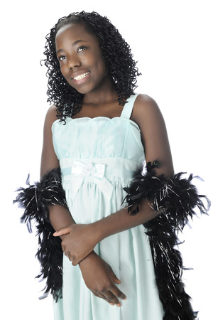 dressy: Portrait of a bautiful black tween in a dressy aqua dress and feathery black boa.  On a white background.