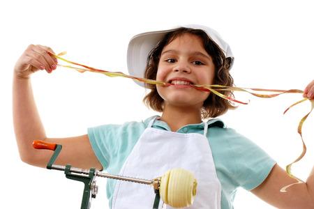 munching: Elementary Pie-Maker Munching on the Peel from Apples