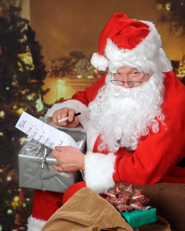 Santa Checking His List in a Decorated Living Room photo