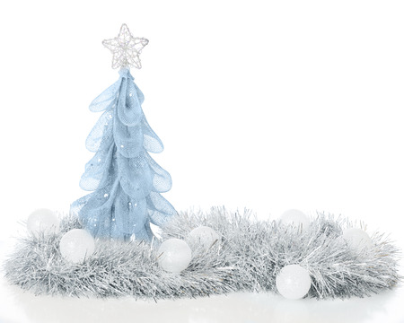 A high key image of a sparkly simulated Christmas tree in silver surrounded by silver garland and frosty white balls   On a white background