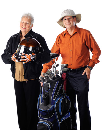 A senior woman biker posing with ther golfing husband.  photo