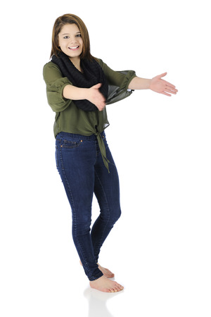 A beautiful, barefoot teen girl happily using her hands to show the viewer how big.  On a white background. photo