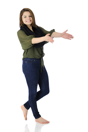 A beautiful, barefoot teen girl happily dancing and clapping in her casual attire   On a white background   Motion blur on clapping hands  photo