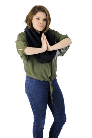 A beautiful teen girl in casual wear expressing herself with silly body language.  On a white background. photo