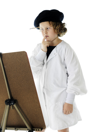 smock: An elementary-aged artist in a French beret and white smock, looking at her work but not sure about what more is needed.  On a white background.