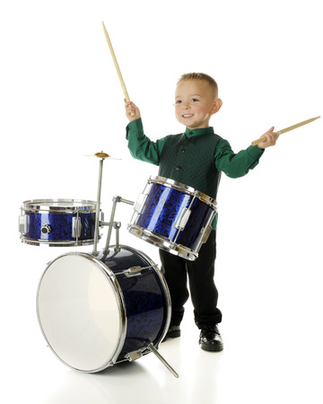 cymbol: An adorable 2-year-old delighted with his just-completed druming performance   On a white background  Stock Photo