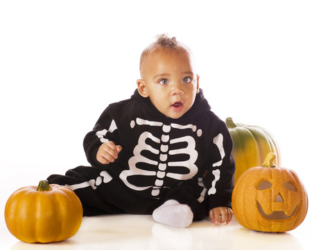 An adorable mixed race baby boy dressed as a skeleton for Halloween   He